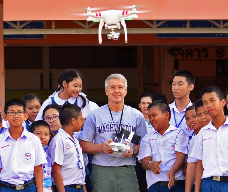Dr. Randy Kyes conducts field course while operating a drone in Thailand.